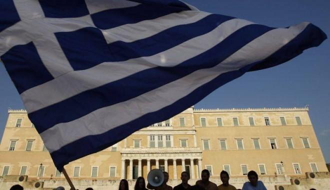 Foto: Grecia salvată de la faliment; băncile private creditoare au acceptat o pierdere de 50%
