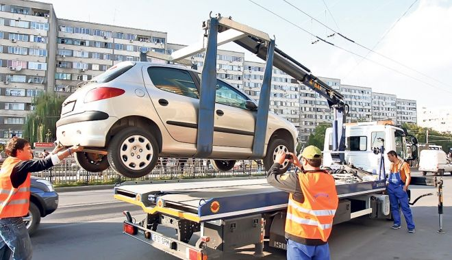 Foto: Tarifele pentru ridicarea maşinilor parcate neregulamentar ar putea scădea