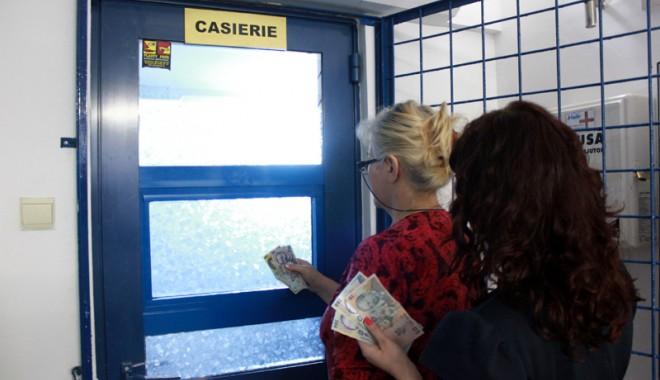 Foto: Cum pot fi determinați restanțierii să plătească întreținerea
