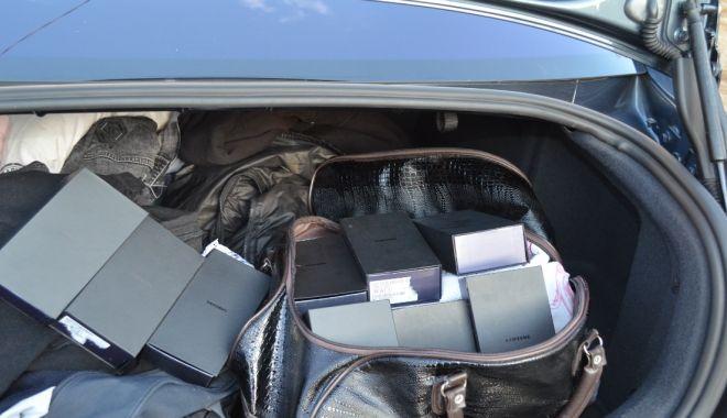 Șofer prins în timp ce voia să introducă în țară telefoane contrafăcute! - 2-1573557612.jpg