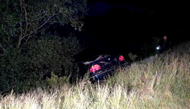 Foto: Unul dintre tinerii care au plonjat cu mașina în apă, reținut. El s-ar fi aflat la volan, și nu una dintre fetele care au murit
