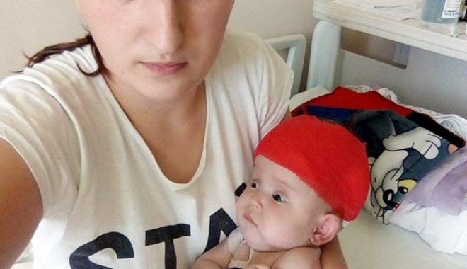 O mamă luptă pentru viața copilului ei. Bebelușul de numai trei luni a suportat deja trei intervenții chirurgicale - bebebolnav-1478880828.jpg