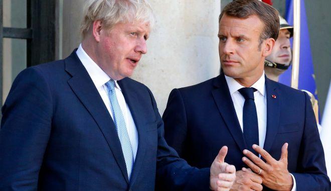 Foto: Boris Johnson l-a avertizat pe Emmanuel Macron că Brexitul nu va fi amânat