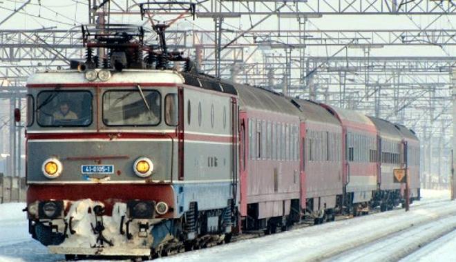 Foto: Cum se călătorește  cu trenul,  în condiții de iarnă
