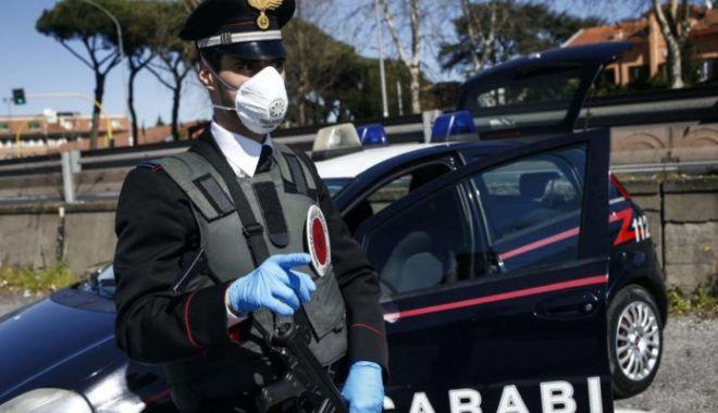 Foto: Român din Italia, cercetat penal după ce a sărit să bată un polițist. Care este motivul