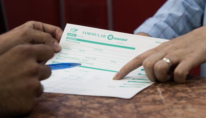 Tot mai multe persoane au apelat la transferurile de bani prin E-mandat - emandat-1590048489.jpg