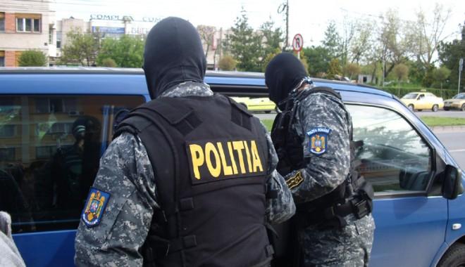 Foto: Percheziții la un post de poliție și domiciliul unui polițist, într-un dosar de corupție