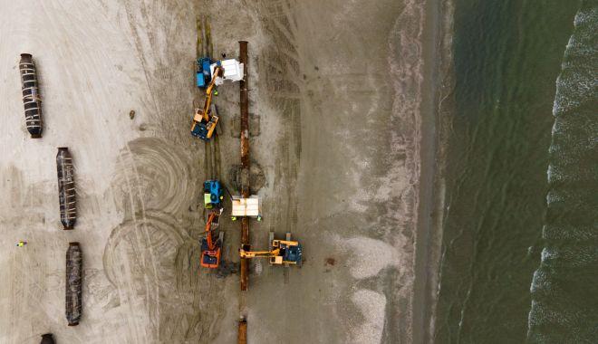 Renasc plajele. Lucrări de înnisipare şi diguri noi, pe litoral - fotofondlucrariplaje4-1601830057.jpg