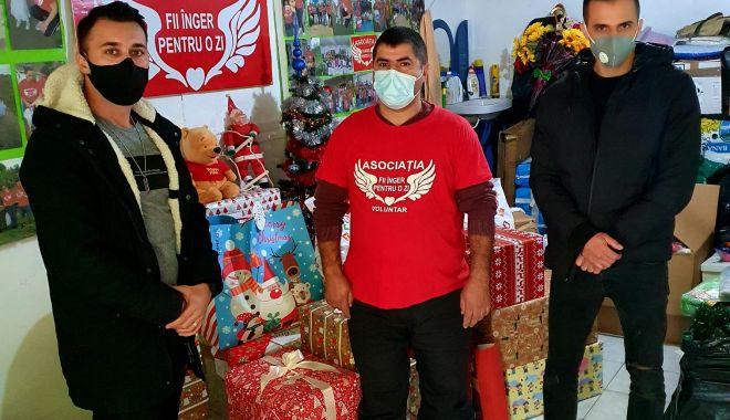 Doi polițiști de frontieră, ajutoarele lui Moș Crăciun la Constanța - gardadonatii2-1607012990.jpg