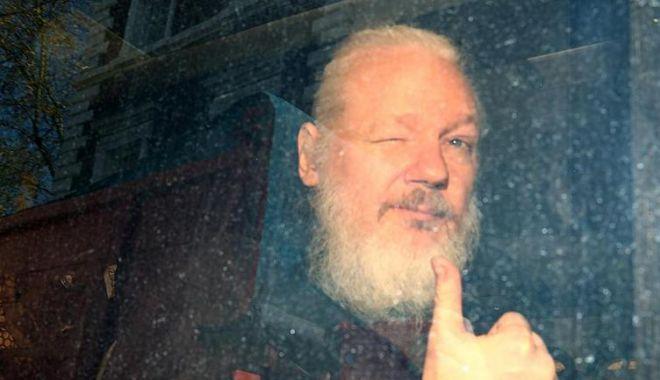 Suedia a renunțat la anchetarea lui Julian Assange privind acuzația de viol - julian-1574180383.jpg