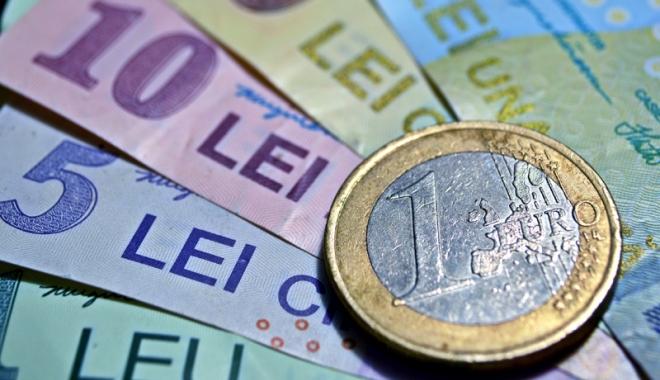 Leul a pierdut la euro și franc, d\r a câștigat la dolar - leul-1516376679.jpg