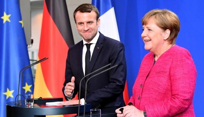 Foto: Macron îi cere lui Merkel să se angajeze în reforma UE și a zonei euro