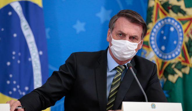 Președintele Braziliei a luat în râs coronavirusul, dar a ajuns la spital cu simptome - masca-1594104183.jpg
