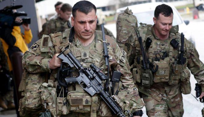 Foto: NATO își suspendă operațiunile de antrenament din Irak