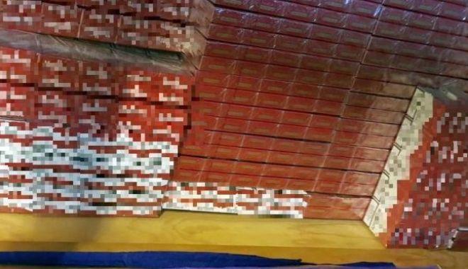Percheziții domiciliare într-un dosar de contrabandă cu țigări. Un bărbat a fost reținut - perchezitii-1592490279.jpg