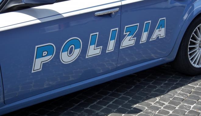 Român împușcat mortal în timp ce jefuia un bar - polizia-1489306571.jpg