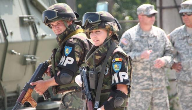Primul detașament de poliție militară comandat de  o femeie se întoarce din Afganistan - primul-1486571969.jpg