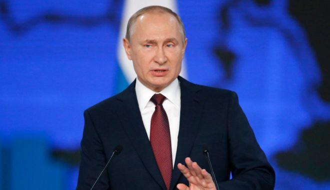 Foto: Putin respinge acuzațiile privind intervenția rusă în alegerile din SUA
