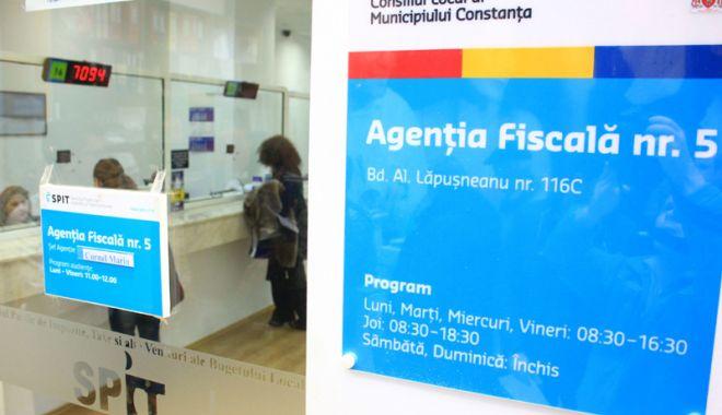 Foto: Impozitele și taxele locale, plătite online,  pe platforma  www.ghiseul.ro