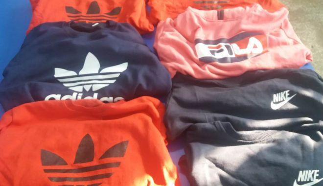Foto: Parfumuri și haine contrafăcute, vândute la Constanța